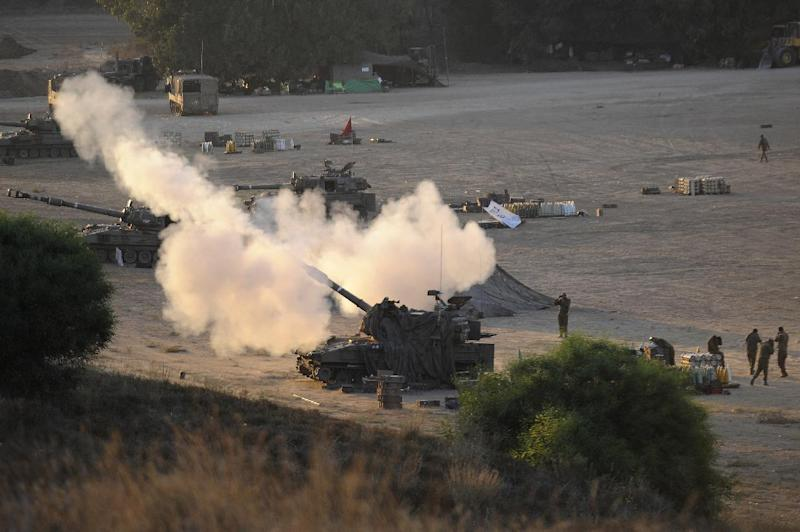 An Israeli tank fires towards targets in the Gaza Strip from their position near Israel's border with the Palestinian enclave on July 23, 2014