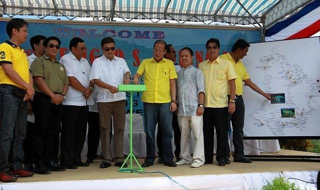 President Benigno Simeon Aquino III and Catanduanes Governor Joseph Cua pushes the button to signal the operation of the Solong and Hitoma 1 Hydroelectric Power Plants during the Inauguration Ceremony at the Barangay Buenavista, Bato, Catanduanes Wednesday May 02, 2012. The Solong and Hitoma mini-hydro plants are the first ever to be developed by a private entity, the Sunwest Water and Electricity, Inc. in the small island grids covered by the Special Power Utilities Group (SPUG) of the National Power Corporation. In the photo are Energy Secretary Jose Rene Almendras, Catanduanes Lone District Representative Cesar Sarmiento and Albay Governor Jose Salceda.  (Jay Morales / MPB / NPPA Images).