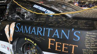 Signatures on Corey LaJoie's of people who donated to Samaritan's Feet. (Photo: Dustin Long)