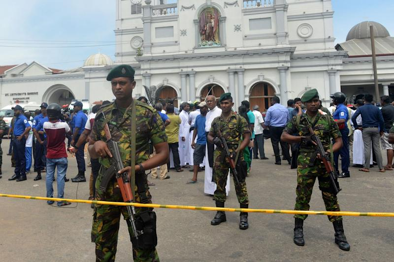 Sri Lankan security personnel keep watch outside the church premises following a blast at the St. Anthony's Shrine in Kochchikade in Colombo. (AFP/Getty Images)