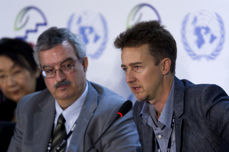 Edward Norton, right, actor and United Nations Goodwill Ambassador for Biodiversity, speaks next to Dr. Braulio Ferreira during a news conference about the Convention on Biological Diversity at the United Nations Conference on Sustainable Development, or Rio+20, in Rio de Janeiro, Brazil, Thursday, June 21, 2012. (AP Photo/Victor R. Caivano)