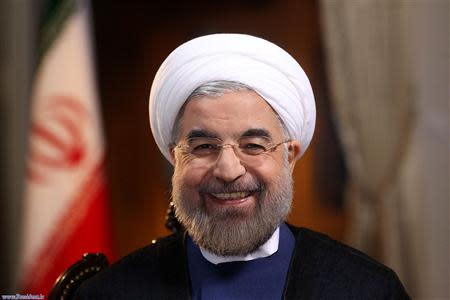 Iranian President Hassan Rouhani smiles during an interview with U.S. television network NBC in Tehran