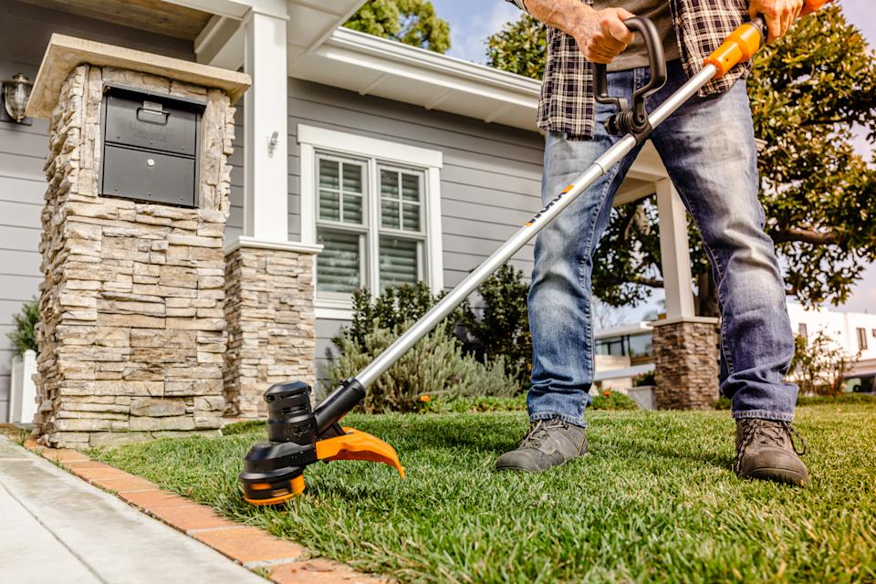 Weeding the lawn with weed whacker and other power tools