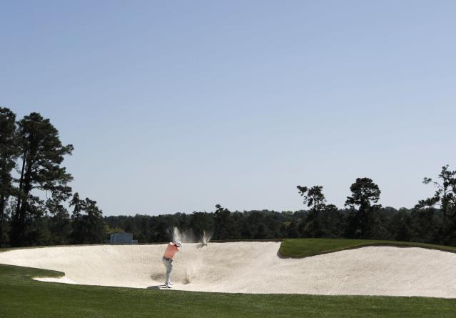 Justin Rose of England hits from a bunker on the second fairway during first round play of the 2018 Masters golf tournament at the Augusta National Golf Club in Augusta, Georgia, U.S., April 5, 2018. REUTERS/Jonathan Ernst