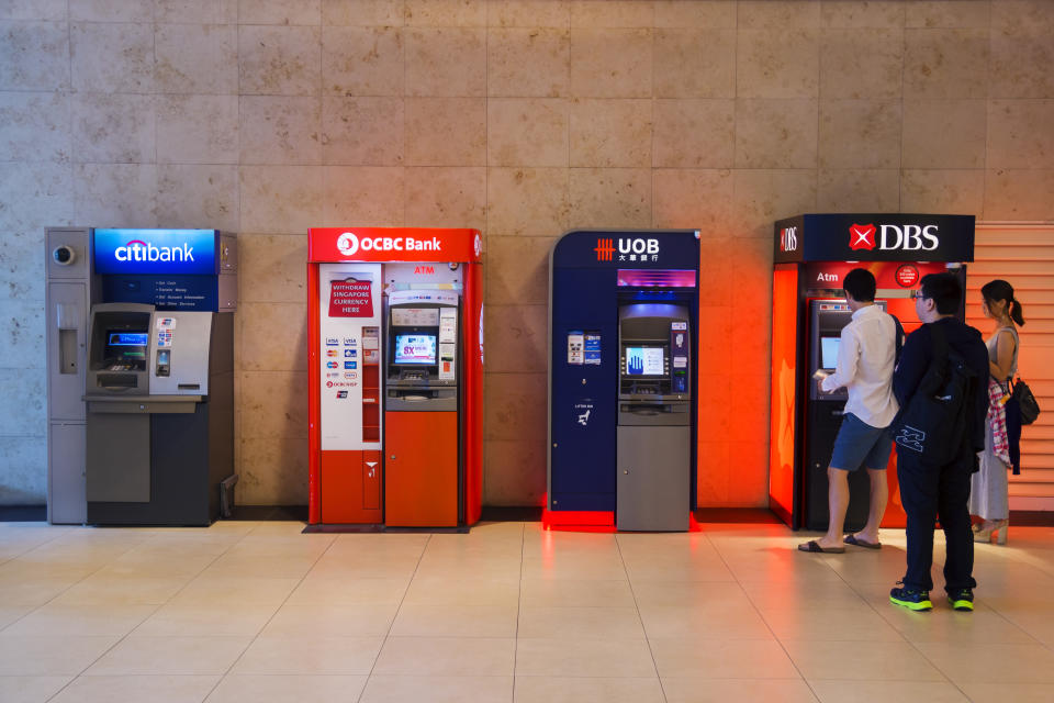 A row of automated teller machines (ATMs) from various local banks at Changi Airport. (PHOTO: Getty Images)