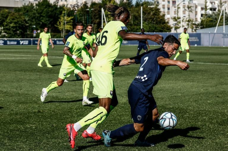 Caen, in green shirts, have been struggling in the second tier of French football