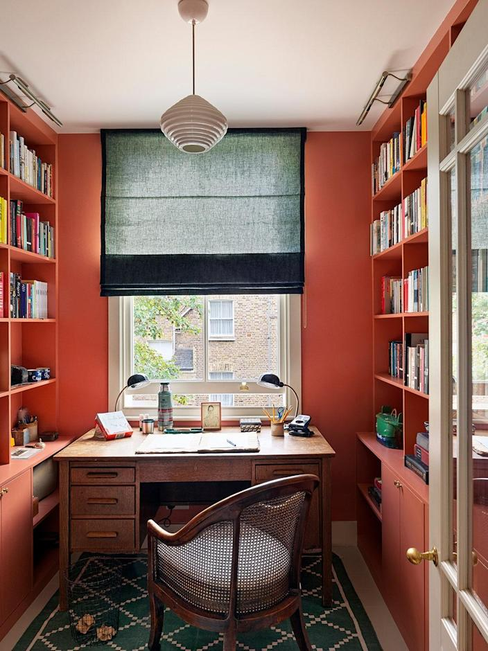 Farrow & Ball's Red Earth was not Beata's first choice for his study but the husband, a writer, was drawn to it.