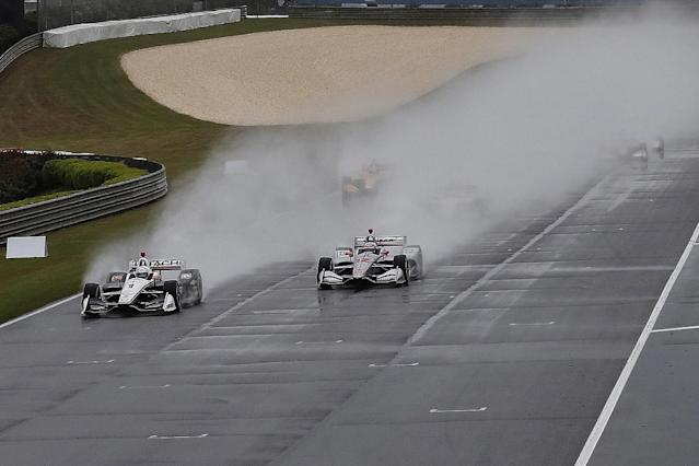 IndyCar's race at Barber has been pushed back until Monday, after running just 22 laps, almost half under yellow flag conditions due to heavy rain and wind.