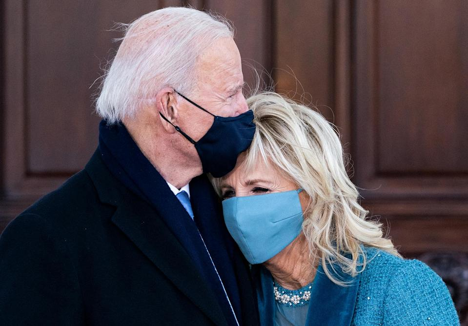 <p>President Joe Biden and First Lady Dr. Jill Biden embrace on the steps of their new home, the White House. </p>