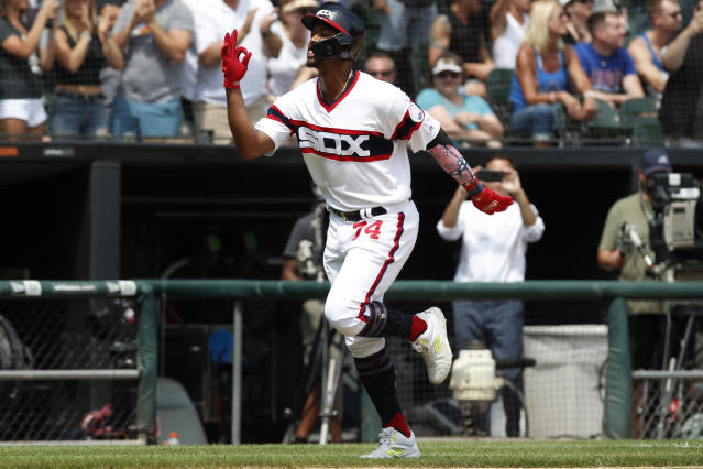 Chicago White Sox's Eloy Jimenez rounds the bases after hitting a two-run home run against the Chicago Cubs during the fourth inning of a baseball game Sunday, July 7, 2019, in Chicago. (AP Photo/Jim Young)