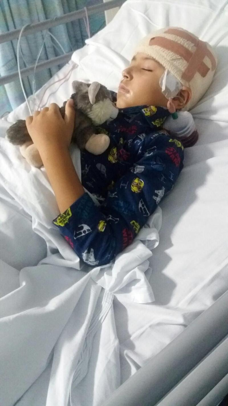 A mum revealed she 'made her son disabled' to save his life - by allowing surgeons to disconnect half his brain. Photo: MEGA