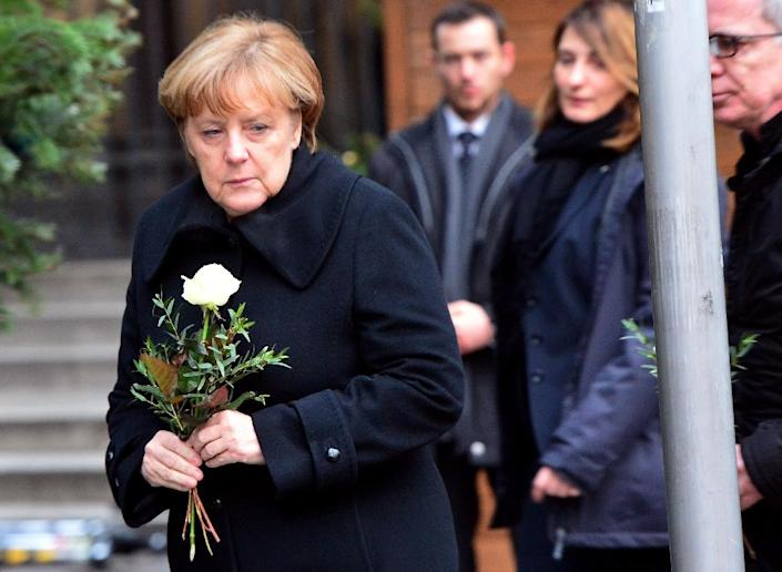 The popularity of German Chancellor Angela Merkel, seen in December laying a flower at the site of the terrorist attack in Berlin, has been weakened by the refugee crisis which has emboldened anti-immigrant factions (AFP Photo/Maurizio Gambarini)