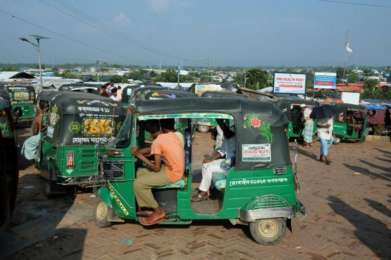 Refugees are taken to checkpoints at the camp's edges by rickshaw drivers, where security forces typically wave them through for a bribe