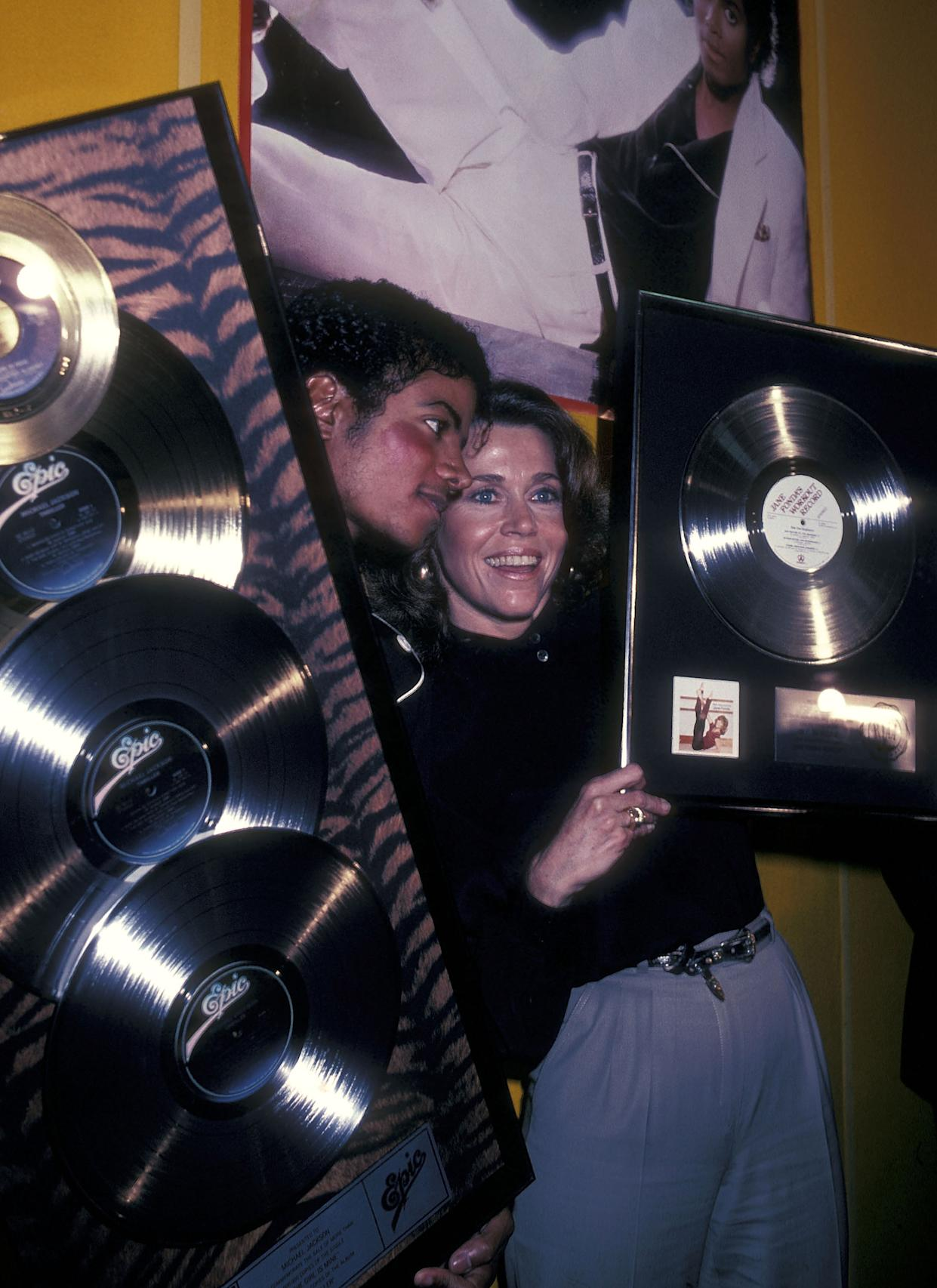 """Michael Jackson and actress Jane Fonda attend the Presentation of Michael Jackson's """"Thriller"""" Album Certified Platinum on February 25, 1983 at CBS Records in Century City, California. (Photo by Ron Galella/Ron Galella Collection via Getty Images)"""