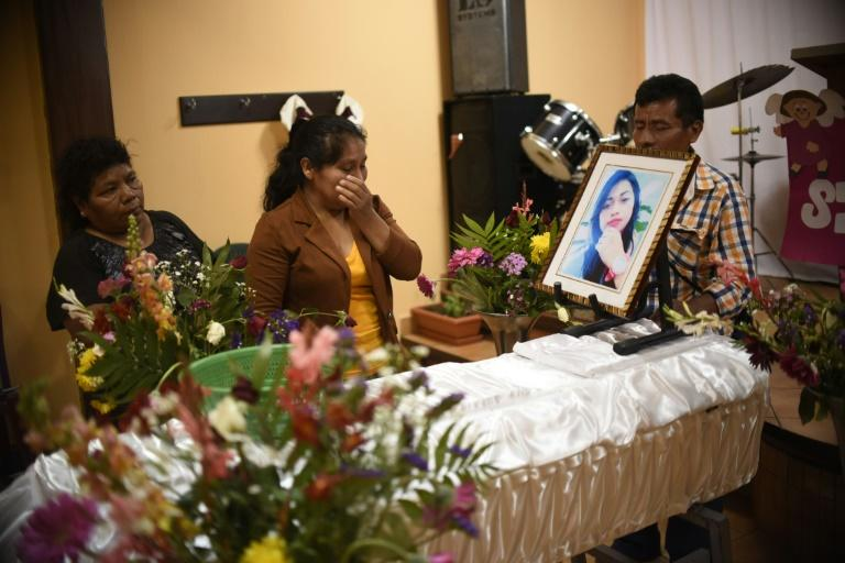 Marta Lidia Garcia (C) cries by the coffin of her 17-year-old daughter, Siona Hernandez, who died in a fire at a state-run shelter, during the wake on March 10, 2017, south of Guatemala City
