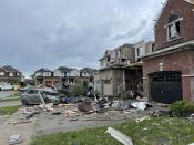 <p>Tornado hits Barrie, Ontario. Residential homes were damaged, cars flipped, and several were left injured after the powerful storm on July 15, 2021. (Brandon Vieira/Twitter)</p>