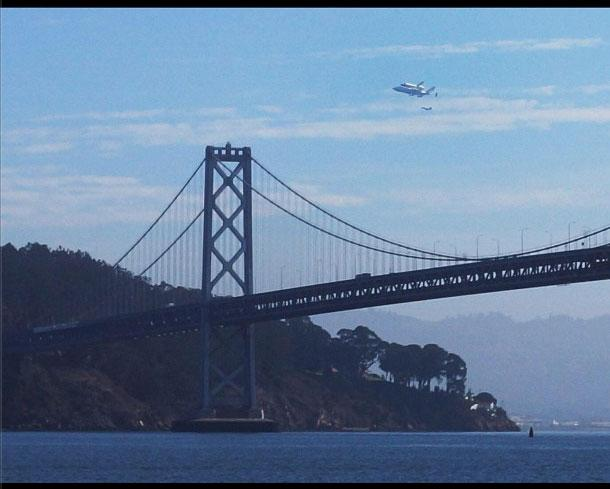 Endeavour soars over Treasure Island and the Bay Bridge. Courtesy of @sheigh