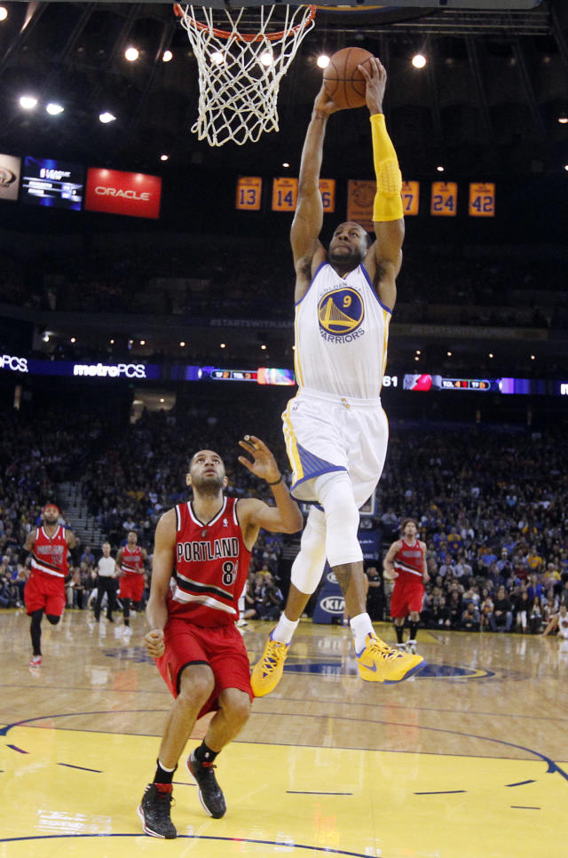 Golden State Warriors' Andre Iguodala (9) dunks past Portland Trail Blazers' Nicolas Batum during the second half of an NBA basketball game on Sunday, Jan. 26, 2014, in Oakland, Calif. Golden State won 103-88. (AP Photo/Marcio Jose Sanchez)