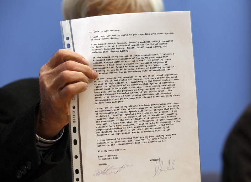 Opposition Greens lawmaker Hans-Christian Stroebele, shows a letter he received from Edward Snowden to the media prior to a press conference in Berlin, Germany, Friday, Nov. 1, 2013. Stroebele said he met Edward Snowden in Moscow on Thursday, and that the National Security Agency leaker is prepared to help Germany investigate allegations of surveillance by U.S. intelligence. Snowden was granted asylum in Russia in August after being stuck at a Moscow airport for more than a month following his arrival there from Hong Kong. The 30-year-old faces espionage charges in the U.S. (AP Photo/Michael Sohn)