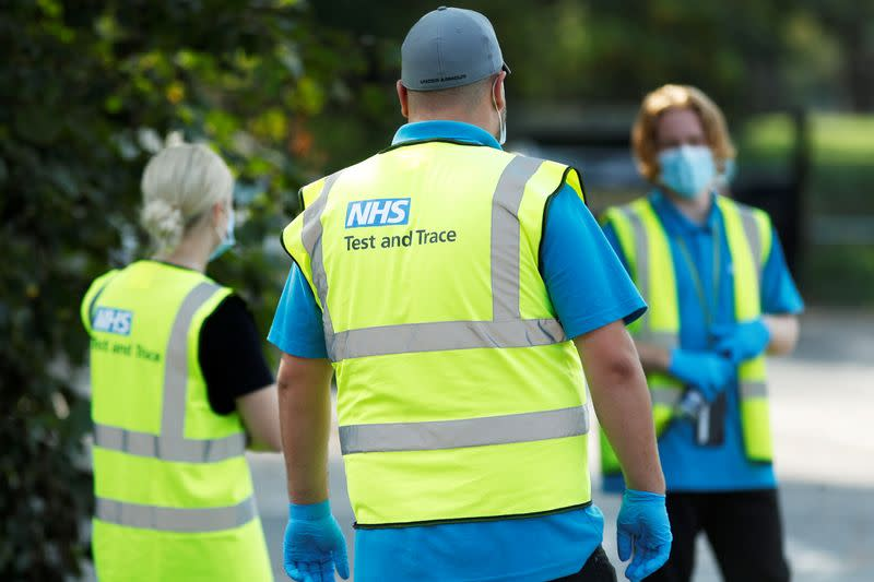 FILE PHOTO: NHS Test and Trace workers are seen at a test station in Richmond-Upon-Thames