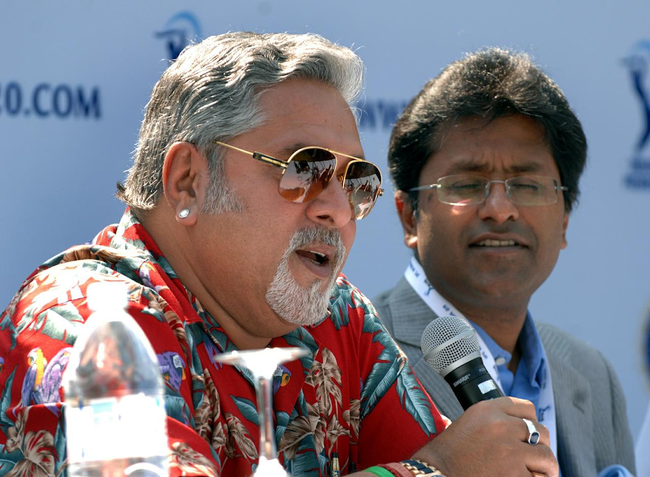 TO GO WITH Cricket-IND-IPL-India-auction  (FILES) In this photograph taken on Februuary 6, 2009, Indian businessman Vijay Mallya (L), co-owner of the Bangalore Royal Challengers, speaks as Lalit Modi of the Indian Premier League looks on during a press conference minutes after the end of the Indian Premier League player auction at Fort Aguada in Goa.   The world's leading cricket players go under the hammer January 8, 2011, for the Indian Premier League auction as the scandal-plagued tournament looks to bounce back with its fourth edition. Former West Indies captain Brian Lara and a host of England's Ashes heroes will be among 350 players going under the hammer at the auction in Bangalore on January 8 and 9.  AFP PHOTO/STR/FILES (Photo credit should read STR/AFP/Getty Images)