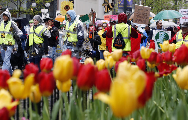"Demonstrators march on the State Street during ""100 Days of Failure"" protest and march, Saturday, April 29, 2016, in Chicago. Thousands of people across the U.S. are marking President Donald Trump's hundredth day in office by marching in protest of his environmental policies. (AP Photo/Nam Y. Huh)"