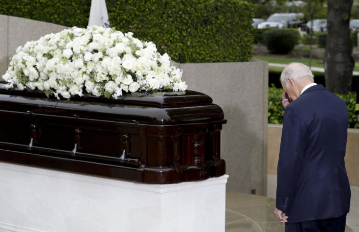 <p>Former White House Chief of Staff James A. Baker pauses at the casket during the graveside service for Nancy Reagan.<i> (Photo: Chris Carlson/AP)</i></p>