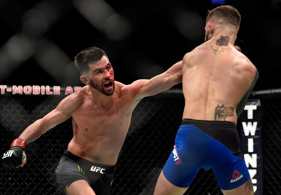 LAS VEGAS, NV - DECEMBER 30:  (L-R) Dominick Cruz punches Cody Garbrandt in their UFC bantamweight championship bout during the UFC 207 event at T-Mobile Arena on December 30, 2016 in Las Vegas, Nevada.  (Photo by Brandon Magnus/Zuffa LLC/Zuffa LLC via Getty Images)