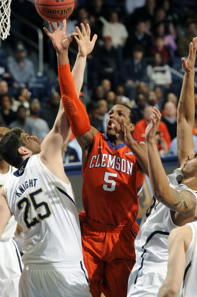 Clemson guard Jaron Blossomgame, center, shoots as Notre Dame forwards Tom Knight, left, and Zach Auguste defend in first half of an NCAA college basketball game, Tuesday, Feb. 11, 2014, in South Bend, Ind. (AP Photo/Joe Raymond)