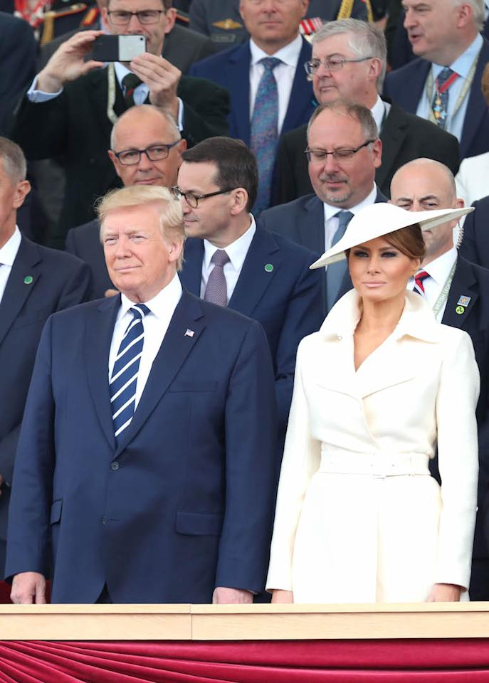 For their final day of the UK state visit in Portsmouth on June 5, Melania Trump opted for another all-cream ensemble in a belted coat and matching hat by the royal's go-to milliner, Philip Treacy. [Photo: Getty]