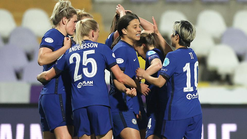 Sam Kerr is seen celebrating Chelsea's win over Wolfsburg with teammates.