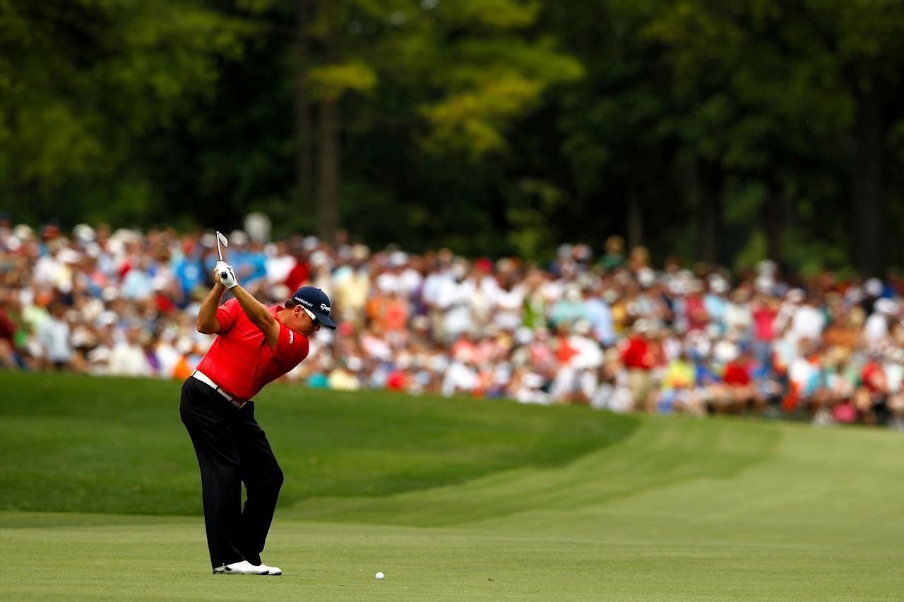 CHARLOTTE, NC - MAY 06:  D.A. Points of the United States hits an approach shot on the third hole during the final round of the Wells Fargo Championship at the Quail Hollow Club on May 6, 2012 in Charlotte, North Carolina.  (Photo by Streeter Lecka/Getty Images)