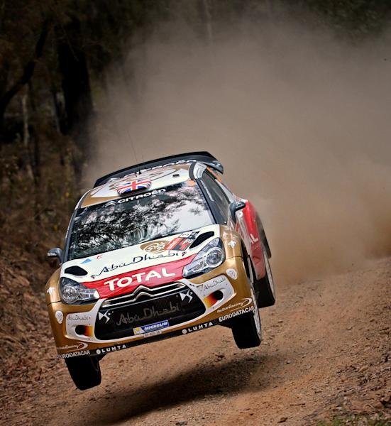In this photo provided by Rally Australia, Kris Meeke of Britain races his car during a road stage of the Rally Australia near Coffs Harbour, Friday, Sept. 13, 2013. Meeke is in third place, 25.9 seconds behind Sebastien Ogier. (AP Photo/Rally Australia)