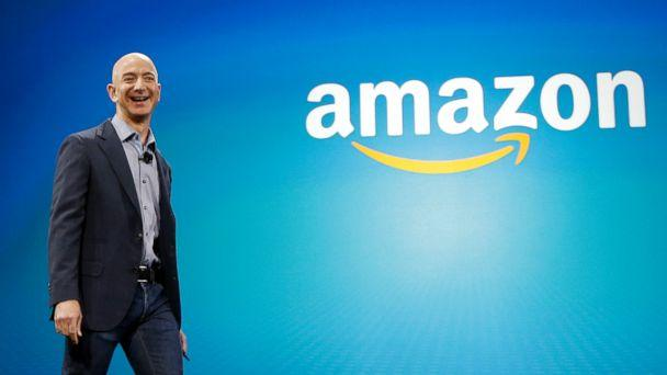 PHOTO: Amazon CEO Jeff Bezos walks onstage for the launch of the new Amazon Fire Phone, in Seattle, June 16, 2014. (Ted S. Warren/AP, FILE)