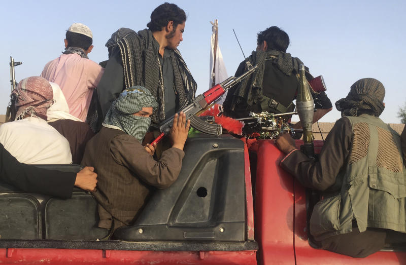 FILE- In this June 16, 2018 photo, Taliban fighters ride in their vehicle in Surkhroad district of Nangarhar province, east of Kabul, Afghanistan. Many Afghans view Saturday's expected signing of a U.S.-Taliban peace deal with a heavy dose of well-earned skepticism. They've spent decades living in a country at war -- some their whole lives — and wonder if they can ever reach a state of peace. (AP Photo/Rahmat Gul, file)