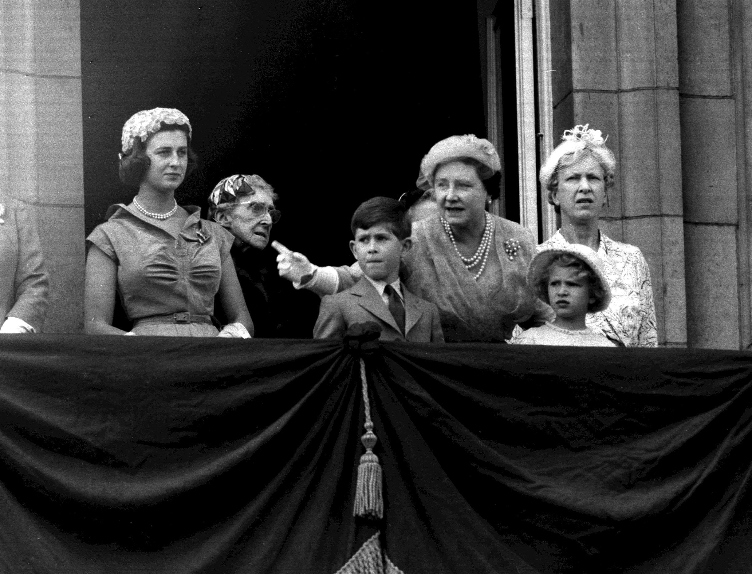 Prince Charles and Princess Anne pictured on the Buckingham Palace in 1956 during Trooping the Colour with the Queen Mother. [Photo: PA]