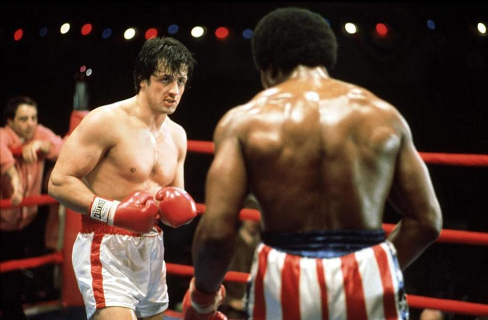 """<a href=""""http://movies.yahoo.com/movie/rocky/"""" data-ylk=""""slk:ROCKY"""" class=""""link rapid-noclick-resp"""">ROCKY</a> (1976) <br>Directed by: <span>John Avildsen</span> <br>Starring: <span>Sylvester Stallone</span>, <span>Talia Shire</span> and <span>Burt Young</span>"""