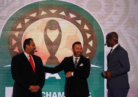 Soccer Football - African Champions League Group Stage Draw - Nile Ritz-Carlton Hotel, Cairo, Egypt - December 28, 2018 Former Egypt players Hazem Emam and Magdi Abdelghani with Anthony Baffoe, CAF deputy general secretary before the CAF Champions League Group Stage Draw REUTERS/Amr Abdallah Dalsh
