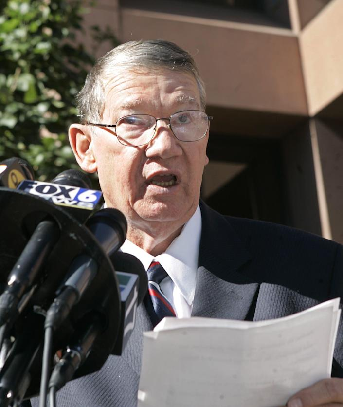 """Republican Congressman Randy """"Duke"""" Cunningham, of the 50th district in California, reads a statement outside the federal courthouse in San Diego on Nov. 28, 2005, where he pled guilty to conspiring to commit bribery, honest services fraud, and tax evasion."""