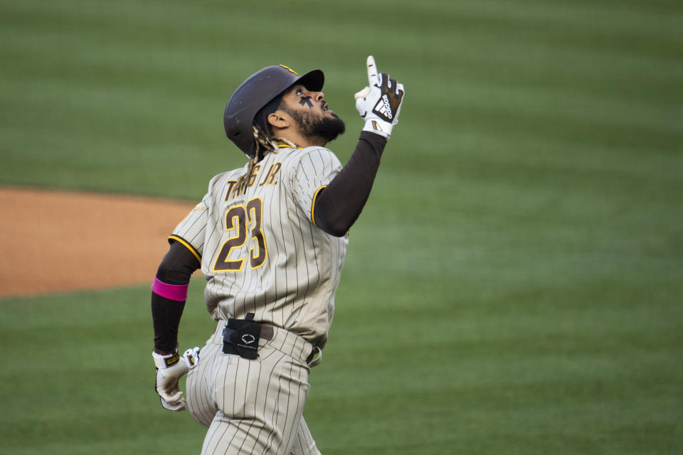 San Diego Padres' Fernando Tatis Jr. celebrates his solo home run during the first inning of a baseball game against the Los Angeles Dodgers in Los Angeles, Saturday, April 24, 2021. (AP Photo/Kyusung Gong)