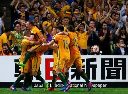 Football Soccer - Australia vs United Arab Emirates - 2018 World Cup Qualifying Asian Zone - Group B - Sydney Football Stadium, Sydney, Australia - 28/3/17 - Australia's players celebrate with teammate Mathew Leckie (7) after Leckie scored a goal against UAE. REUTERS/David Gray