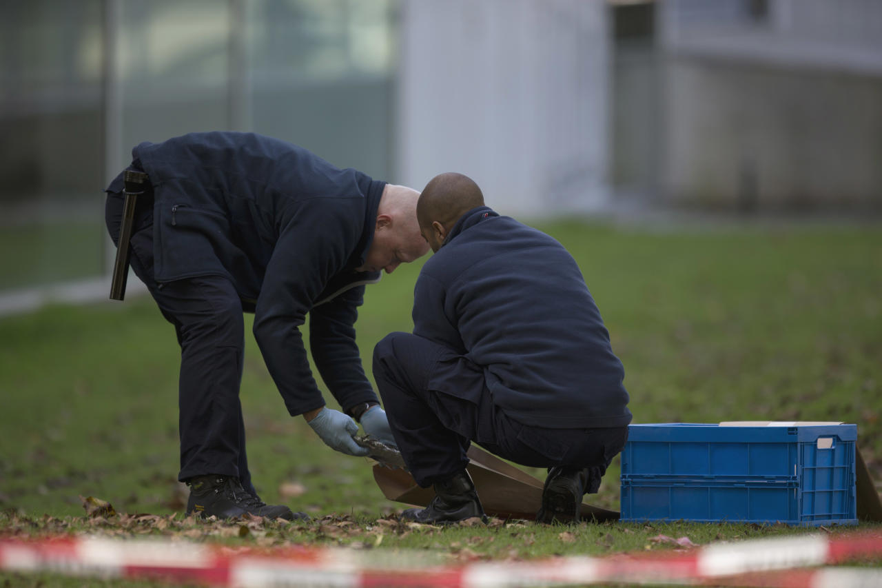 "Forensic experts take samples of imprints at Kunsthal museum in Rotterdam, Netherlands, Tuesday Oct. 16, 2012. Several paintings have been stolen from a museum in the Dutch city of Rotterdam that was exhibiting works by Pablo Picasso, Henri Matisse and Vincent van Gogh. At least several paintings were stolen early Tuesday morning from the Kunsthal museum , but their names have not yet been released. They are believed to include at least one by Henri Matisse, the 1919 ""Reading Girl."" (AP Photo/Peter Dejong)"