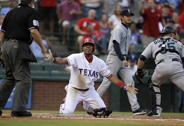 Texas Rangers' Elvis Andrus, center, pleads with home plate umpire Doug Eddingsl, left, after being called out trying to score in the first inning of a baseball game, as Seattle Mariners' Humberto Quintero (35) and Hisashi Iwakuma, rear, of Japan walk away, Friday, Aug. 16, 2013, in Arlington, Texas. (AP Photo/Tony Gutierrez)