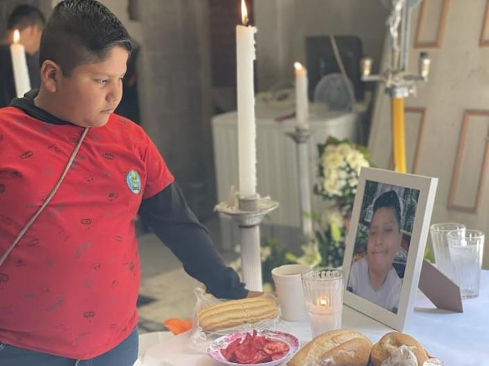 Bryan Osvaldo Hernandez, 10 (left) looks at altar placed for his brother and victim Brandon Giovanni Hernandez Tapia , 12 (in photo table). Brandon Giovannis family set up an altar in his honor at his family home in the Tlahuac neighborhood of Mexico City, to commemorate Brandon Giovannis passing on May 3. He was the youngest victim of the Metro accident on May 3 , Mexico City where 26 were killed.