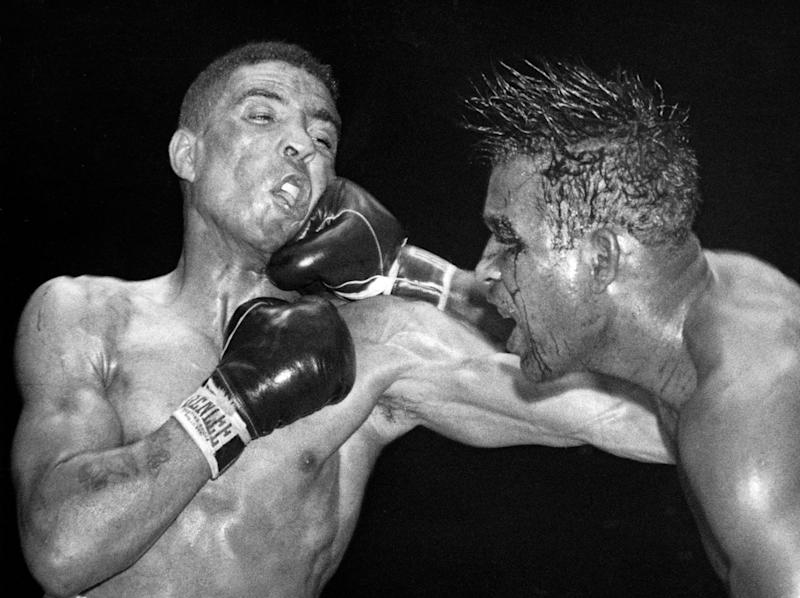 Sugar Ray Robinson throws a hard right to the jaw of Randolph Turpin: Getty