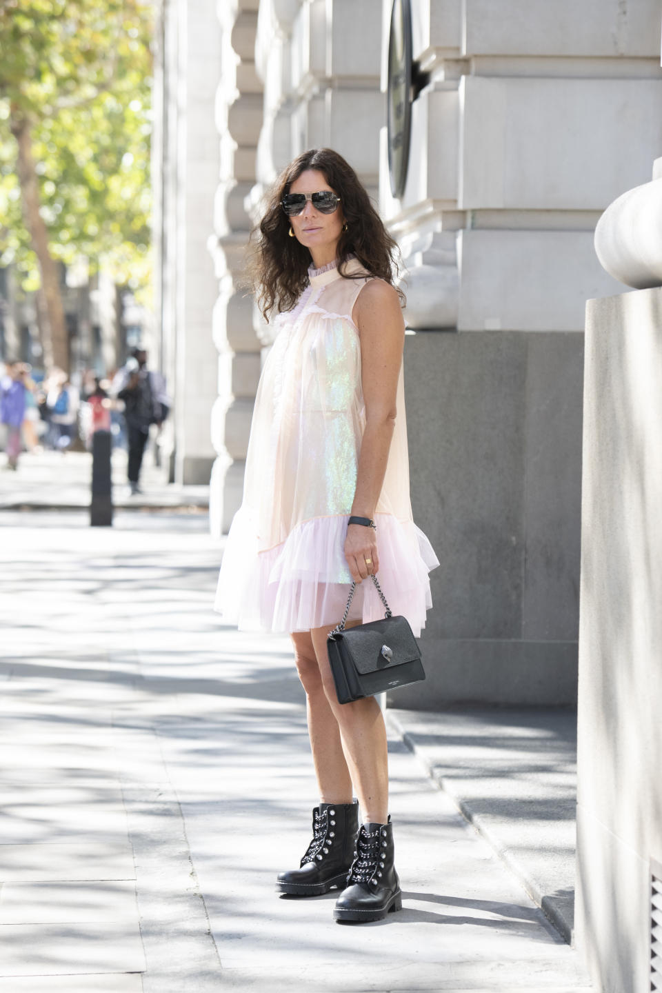 """Hedvig Sagfjord Opshaug is seen wearing Givenchy sunglasses, Bora Aksu dress and Kurt Geiger boots and bag. <a href=""""https://fave.co/2ZQU1on"""" rel=""""nofollow noopener"""" target=""""_blank"""" data-ylk=""""slk:Shop the boots here"""" class=""""link rapid-noclick-resp"""">Shop the boots here </a>[Photo: Getty Images]"""