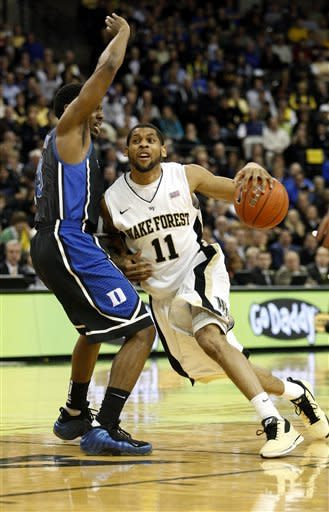 Wake Forest guard C.J. Harris (11) drives against Duke guard Tyler Thornton in the first half of an NCAA college basketball game Tuesday, Feb. 28, 2012 in Winston-Salem, N.C. (AP Photo/Nell Redmond)