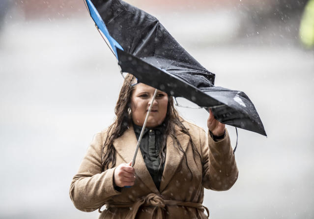 A fan arrives in the heavy rain for the Premier League match at Bramall Lane between Sheffield United and AFC Bournemouth. (PA)