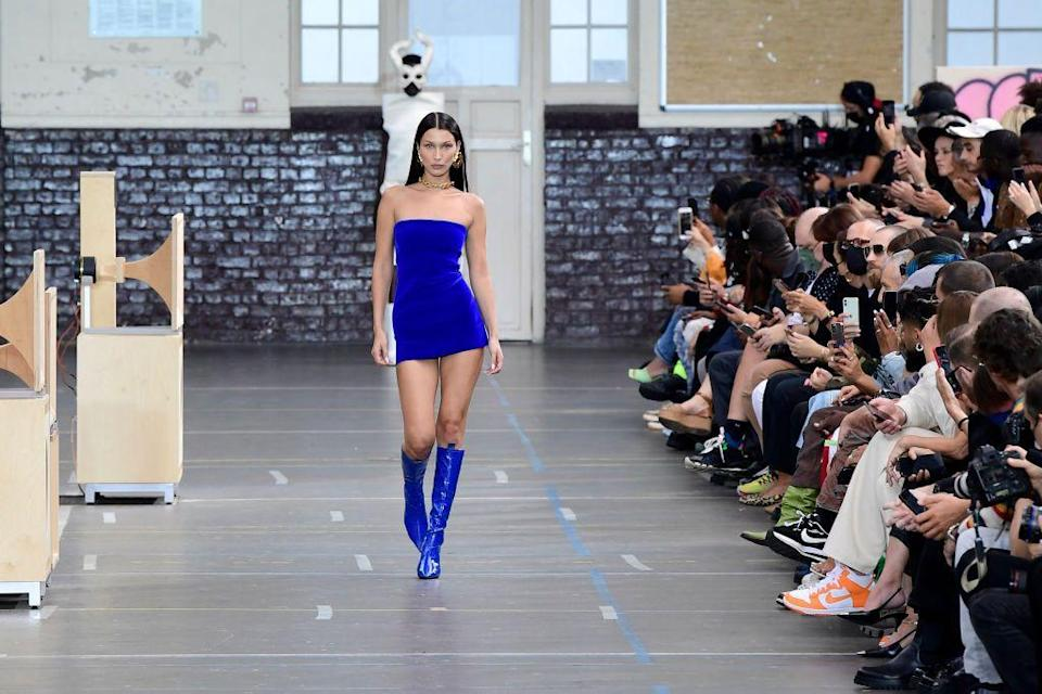 """<p><a href=""""https://www.elle.com/uk/fashion/a31146630/gigi-bella-yolanda-hadid-paris-fashion-week/"""" rel=""""nofollow noopener"""" target=""""_blank"""" data-ylk=""""slk:Bella Hadid"""" class=""""link rapid-noclick-resp"""">Bella Hadid</a> might have started out a tad later than her sister <a href=""""https://www.elle.com/uk/fashion/articles/g31503/gigi-hadid-best-runway-looks/"""" rel=""""nofollow noopener"""" target=""""_blank"""" data-ylk=""""slk:Gigi Hadid"""" class=""""link rapid-noclick-resp"""">Gigi Hadid </a>when it comes to appearing in all the top runway show for the major fashion houses, but after a very successful couple of last seasons, we predict big things to continue for her in SS21. See it all unfold here. </p>"""