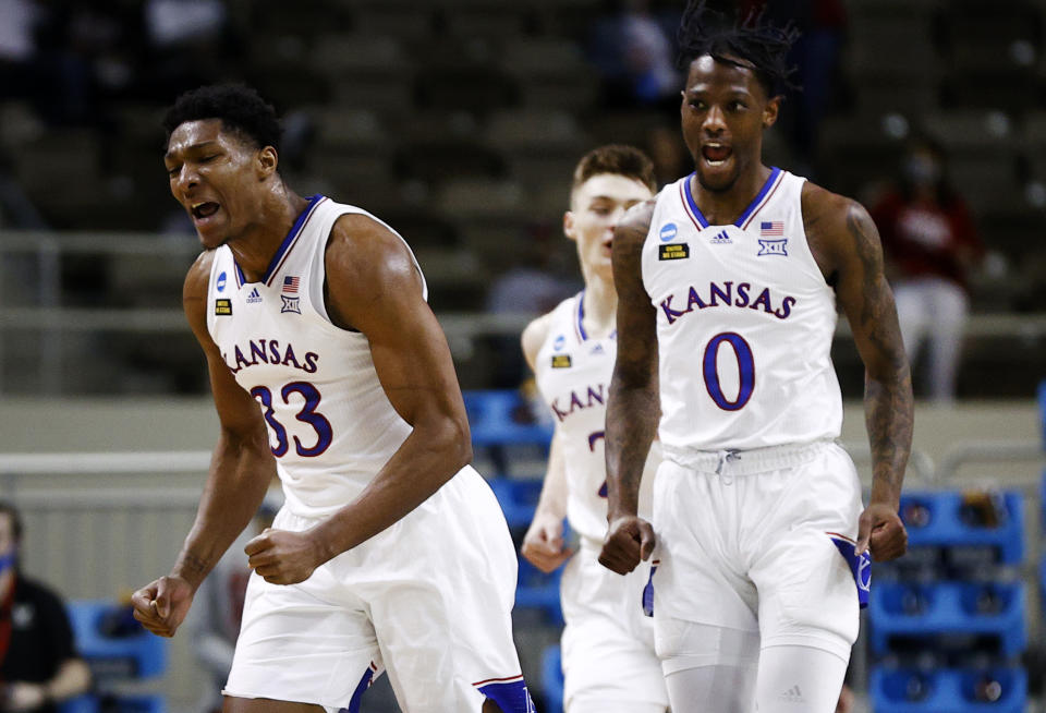 David McCormack #33 of the Kansas Jayhawks and Marcus Garrett #0 of the Kansas Jayhawks react to a basket during the first half against the Eastern Washington Eagles in the first round game of the 2021 NCAA Men's Basketball Tournament at Indiana Farmers Coliseum on March 20, 2021 in Indianapolis, Indiana. (Photo by Maddie Meyer/Getty Images)